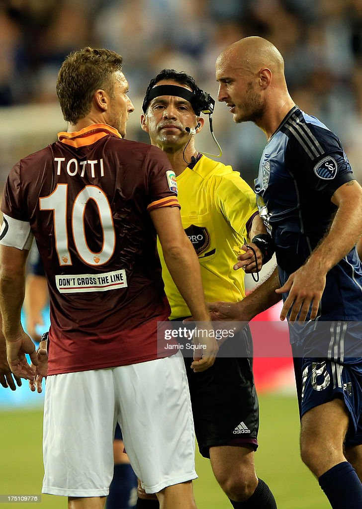 Referee Hilario Grajeda mediates before an argument occurs between Franceso Totti #10 of AS Roma and Aurélien Collin #78 of the MLS All-Stars during the 2013 Major League Soccer All Star Game at Sporting Park on July 31, 2013 in Kansas City, Kansas.