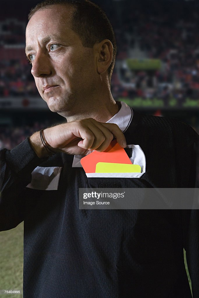 Referee holding red card : Stock Photo