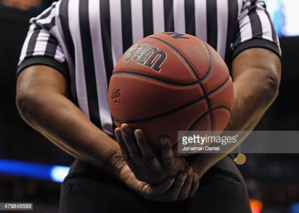 A referee holds the ball during a timeout between the Wisconsin Badgers and the American Eagles at BMO Harris Bradley Center on March 20 2014 in...