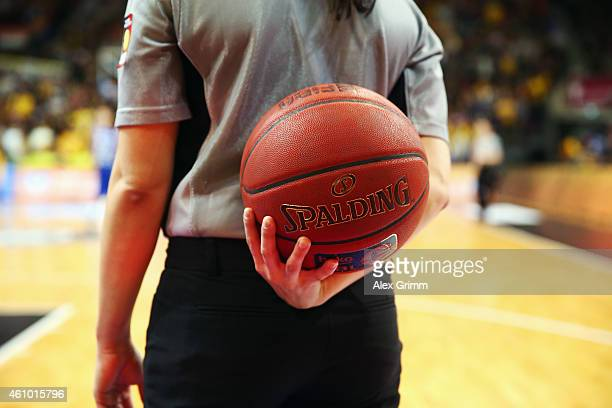 A referee holds the ball during the Beko BBL basketball match between MHP Riesen Ludwigsburg and Fraport Skyliners at MHP Arena on December 30 2014...