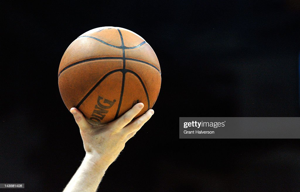 A referee holds the ball up as he waits for play to resume between the Boston Celtics and the Atlanta Hawks in Game One of the Eastern Conference...