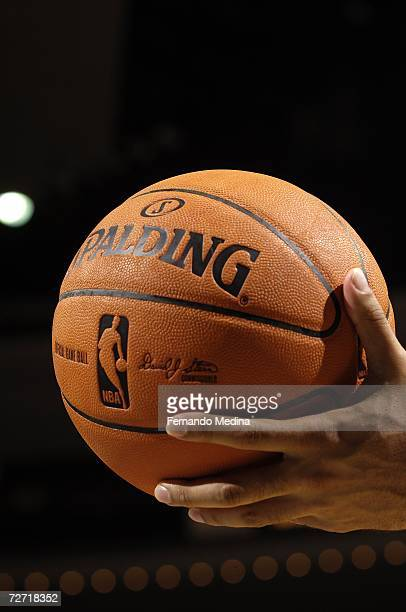 A referee holds the official NBA game ball out during the game between the Orlando Magic against the Atlanta Hawks on October 17 2006 at the TD...