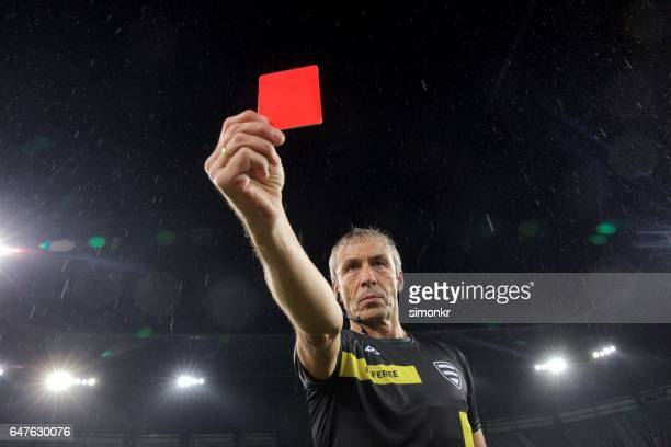 Referee holds up red card