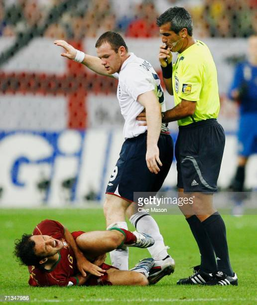 Referee Horacio Elizondo of Argentina blows his whistle after Wayne Rooney of England stamped on Ricardo Carvalho of Portugal during the FIFA World...