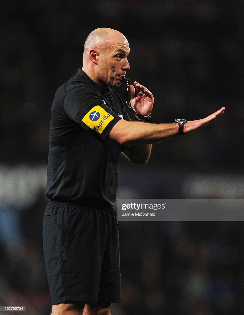 Referee <a gi-track='captionPersonalityLinkClicked' href=/galleries/search?phrase=Howard+Webb&family=editorial&specificpeople=647148 ng-click='$event.stopPropagation()'>Howard Webb</a> blows his whistle during the Barclays Premier League match between West Ham United and Tottenham Hotspur at the Boleyn Ground on February 25, 2013 in London, England.