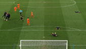 Referee Howard Webb blows the final whistle as the Spain team celebrate winning the World Cup and the Netherlands team look dejected during during...