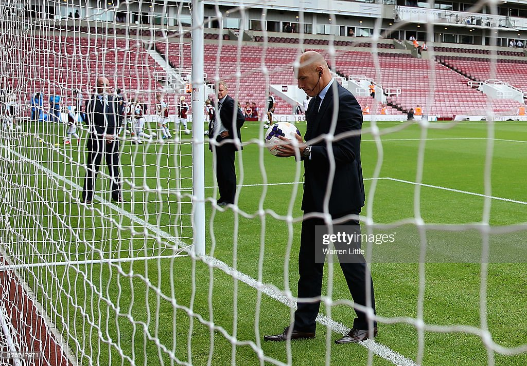 Referee <a gi-track='captionPersonalityLinkClicked' href=/galleries/search?phrase=Howard+Webb&family=editorial&specificpeople=647148 ng-click='$event.stopPropagation()'>Howard Webb</a> checks the new goal-line technology prior during the Barclays Premier League match between West Ham United and Cardiff City at Boleyn Ground on August 17, 2013 in London, England.