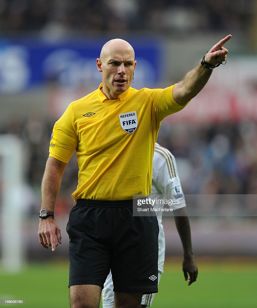 Referee <a gi-track='captionPersonalityLinkClicked' href=/galleries/search?phrase=Howard+Webb&family=editorial&specificpeople=647148 ng-click='$event.stopPropagation()'>Howard Webb</a> during the FA Cup Third Round match between Swansea City and Arsenal at the Liberty Stadium on January 6, 2013 in Swansea, Wales.