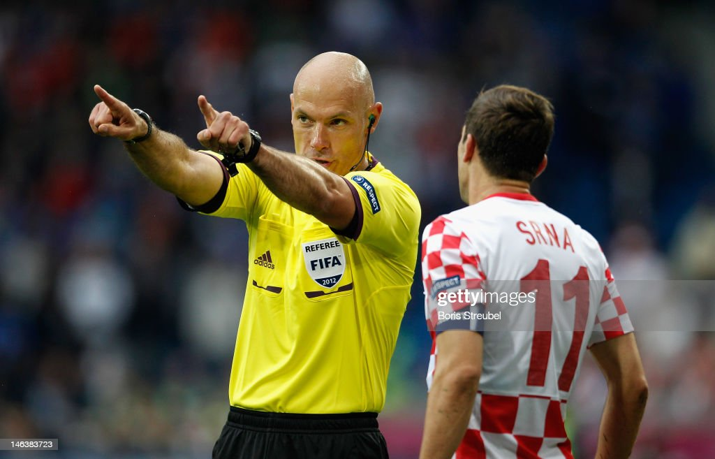 Referee Howard Webb gestures during the UEFA EURO 2012 group C match between Italy and Croatia at The Municipal Stadium on June 14, 2012 in Poznan, Poland.