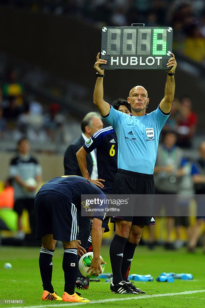 Referee Howard Webb indicates that Hiroki Sakai of Japan will be substituted by Atsuto Uchida during the FIFA Confederations Cup Brazil 2013 Group A match between Japan and Mexico at Estadio Mineirao on June 22, 2013 in Belo Horizonte, Brazil.
