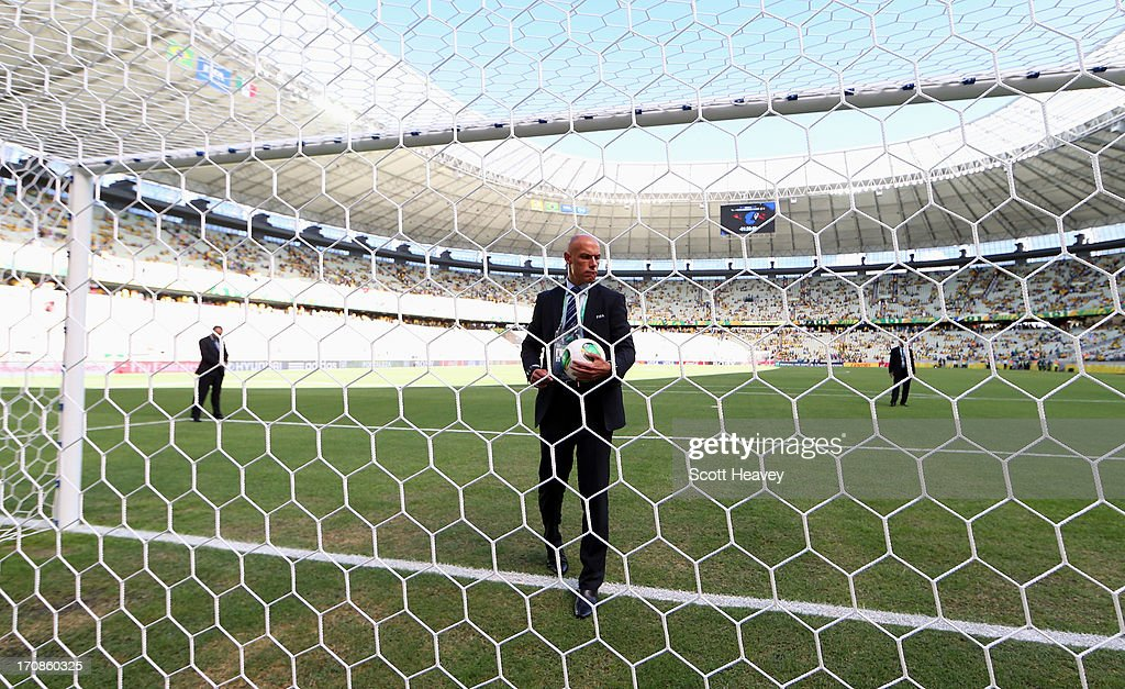 Referee Howard Webb inspects the goal prior to the FIFA Confederations Cup Brazil 2013 Group A match between Brazil and Mexico at Castelao on June 19, 2013 in Fortaleza, Brazil.