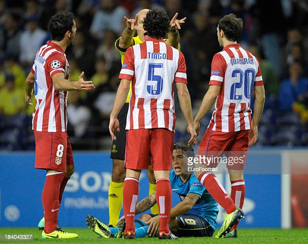 Referee Howard Webb is confronted by Tiago of Club Atletico de Madrid during the UEFA Champions League group stage match between FC Porto and Club...