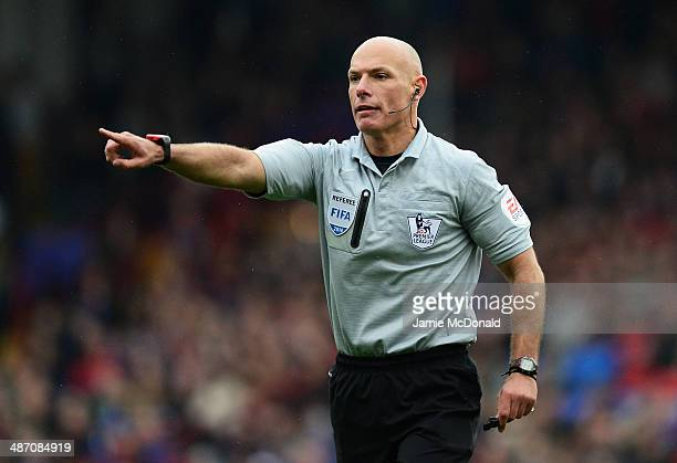 Referee Howard Webb makes his point during the Barclays Premier League match between Crystal Palace and Manchester City at Selhurst Park on April 27...