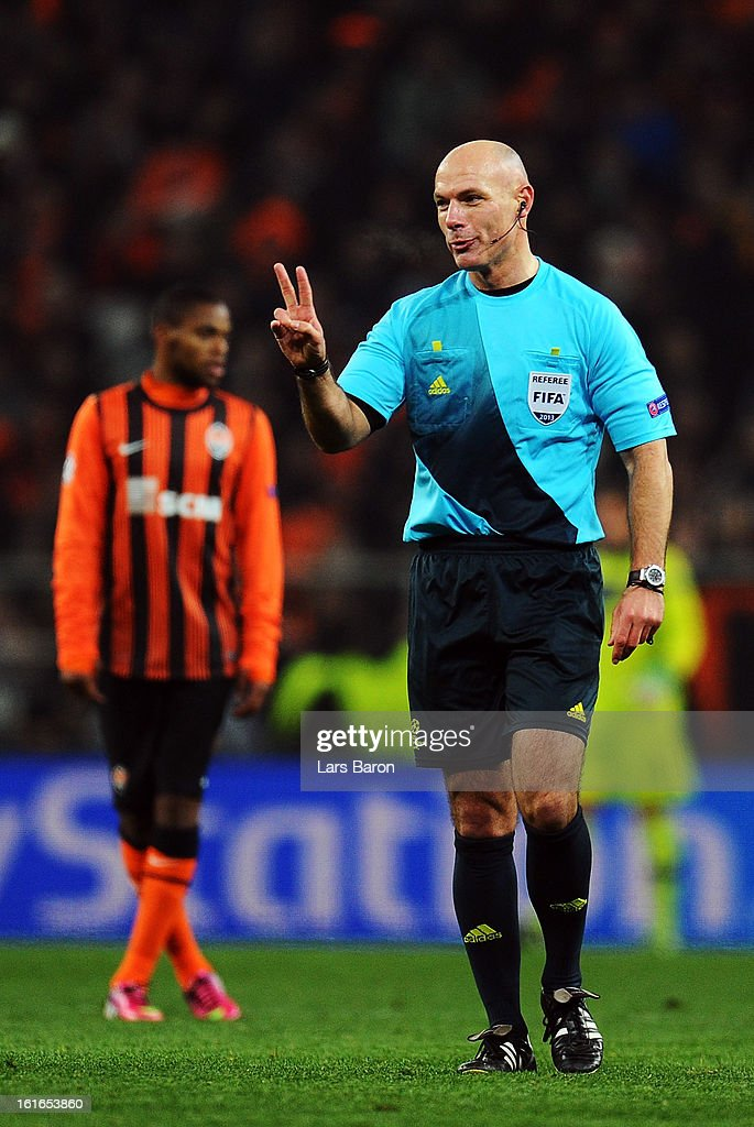 Referee Howard Webb of England gestures during the UEFA Champions League Round of 16 first leg match between Shakhtar Donetsk and Borussia Dortmund at Donbass Arena on February 13, 2013 in Donetsk, Ukraine.