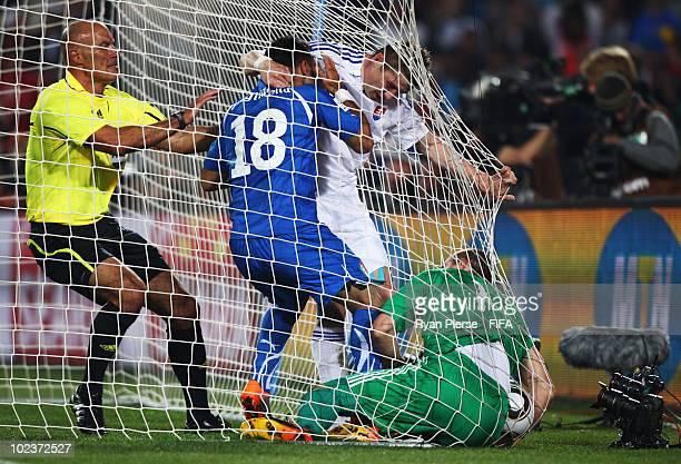Referee Howard Webb of England intervenes as Fabio Quagliarella of Italy tussles with Juraj Kucka of Slovakia and goalkeeper Jan Mucha of Slovakia...