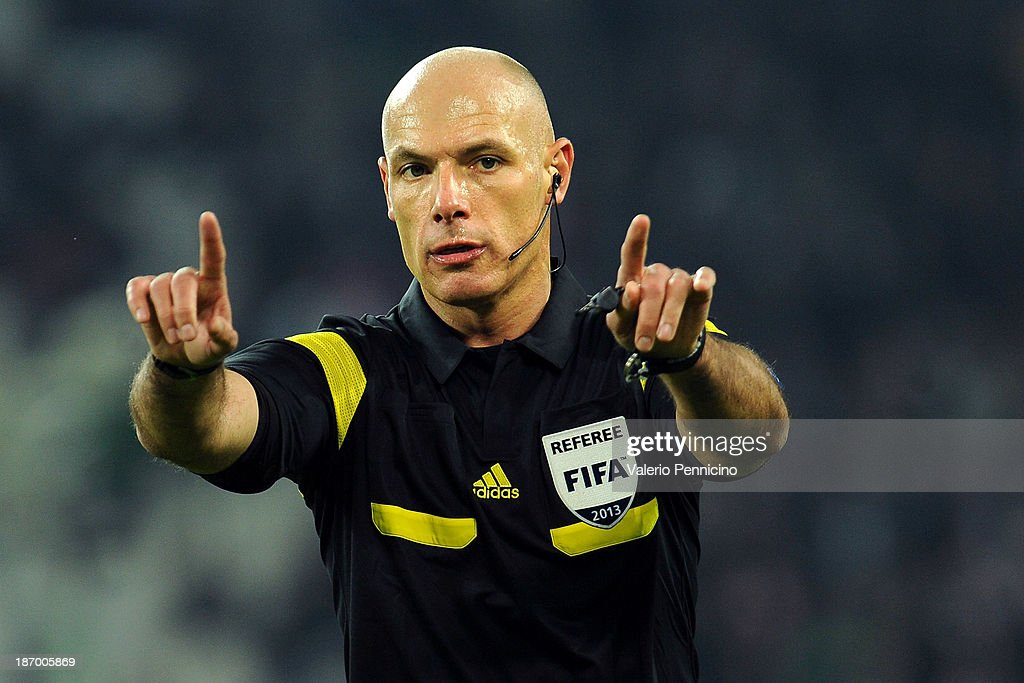 Referee <a gi-track='captionPersonalityLinkClicked' href=/galleries/search?phrase=Howard+Webb&family=editorial&specificpeople=647148 ng-click='$event.stopPropagation()'>Howard Webb</a> of Great Britain signals a foul during the UEFA Champions League Group B match between Juventus and Real Madrid at Juventus Arena on November 5, 2013 in Turin, Italy.