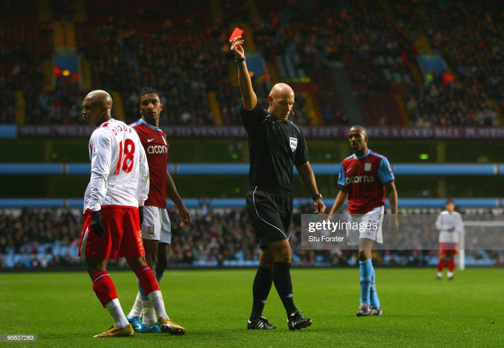Referee Howard Webb sends off Blackburn striker <a gi-track='captionPersonalityLinkClicked' href=/galleries/search?phrase=El-Hadji+Diouf&family=editorial&specificpeople=204332 ng-click='$event.stopPropagation()'>El-Hadji Diouf</a> during the FA Cup sponsored by E.ON 3rd Round match between Aston Villa and Blackburn Rovers at Villa Park on January 2, 2010 in Birmingham, England.