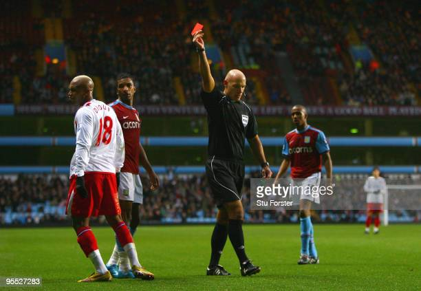 Referee Howard Webb sends off Blackburn striker ElHadji Diouf during the FA Cup sponsored by EON 3rd Round match between Aston Villa and Blackburn...
