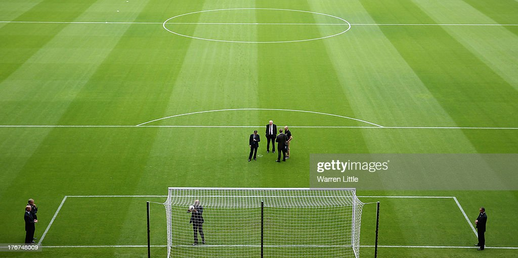 Referee <a gi-track='captionPersonalityLinkClicked' href=/galleries/search?phrase=Howard+Webb&family=editorial&specificpeople=647148 ng-click='$event.stopPropagation()'>Howard Webb</a> tests the new goal line technology ahead during the Barclays Premier League match between West Ham United and Cardiff City at Boleyn Ground on August 17, 2013 in London, England.