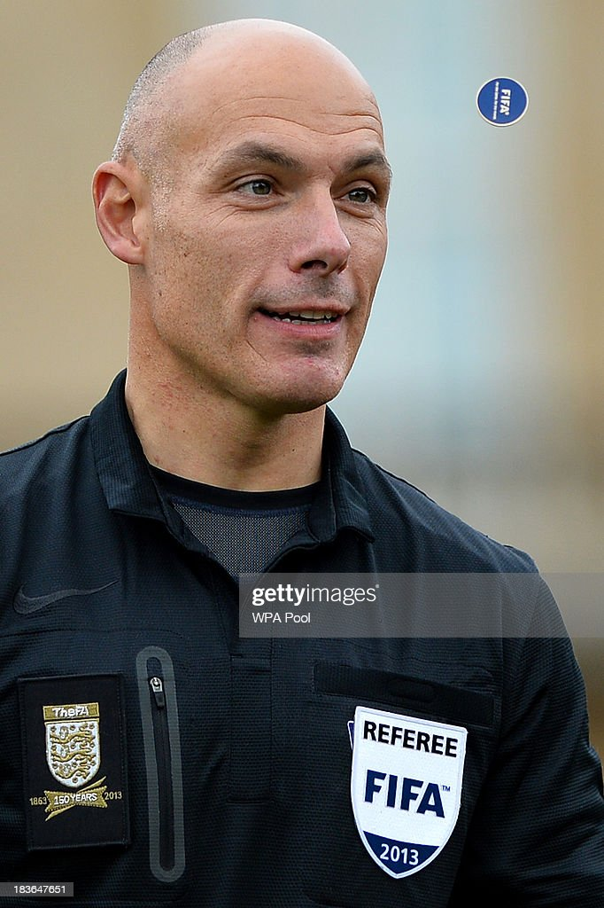 Referee Howard Webb tosses a FIFA coin as Polytechnic FC prepare to play Civil Service FC in a Southern Amateur League football match in the grounds of Buckingham Palace to mark the Football Association's 150th anniversary, on October 7, 2013 in London, England. The President of the Football Association, Prince William, Duke of Cambridge, will host the football match between Civil Service FC and Polytechnic FC, and will also host a reception to celebrate The FA's 150 grassroot heroes.