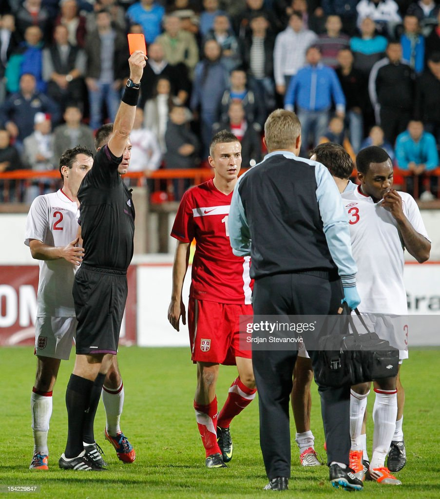 Referee Huseyin Gocek shows the red card to Danny Rose (R) of England after the Under 21 European Championship Play Off second leg match between Serbia U21 and England U21 at Stadium Mladost on October 16, 2012 in Krusevac, Serbia.