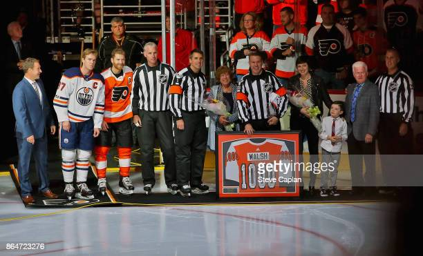 Referee Ian Walsh is honored in a pregame ceremony to celebrate his 1000th NHL game officiated on October 21 2017 at the Wells Fargo Center in...