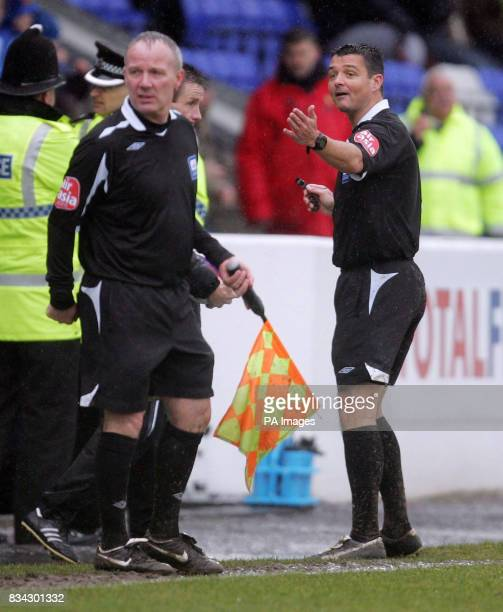 Referee Ian Williamson calls the managers as he abandons the CocaCola League Two match due to the wet conditions at the Deva Stadium Chester