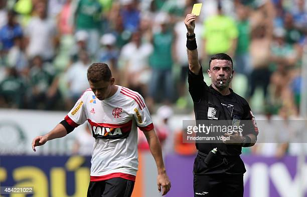Referee Igor Junio Benevenuto givs the yellow card to Jonas of Flamengo during the match between Palmeiras and Flamengo for the Brazilian Series A...