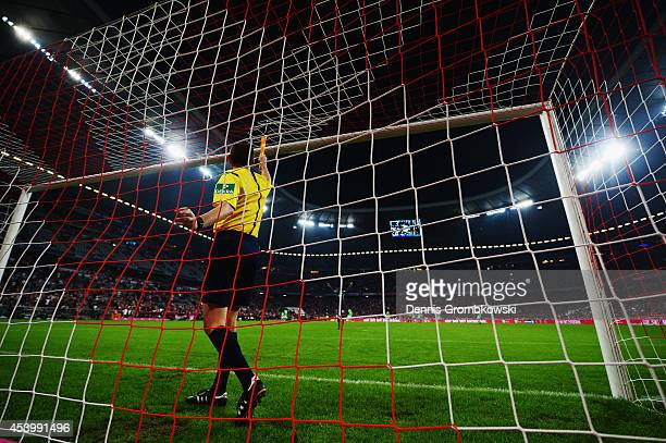 Referee inspects the goal after half time during the Bundesliga match between FC Bayern Muenchen and VfL Wolfsburg at Allianz Arena on August 22 2014...