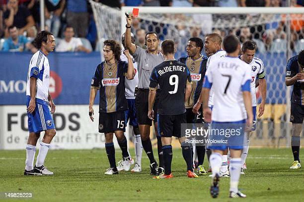 MLS referee Ismail Elfath gives a red card to Jack McInerney of the Philadelphia Union during the match against the Montreal Impact at the Saputo...