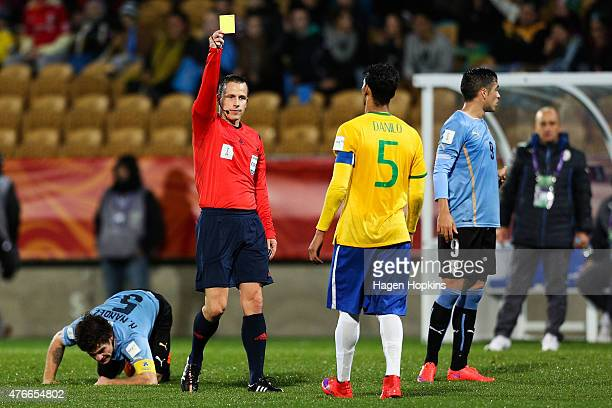 Referee Istvan Vad of Hungary shows Danilo of Brazil a yellow card during the FIFA U20 World Cup New Zealand 2015 Round of 16 match between Brazil...