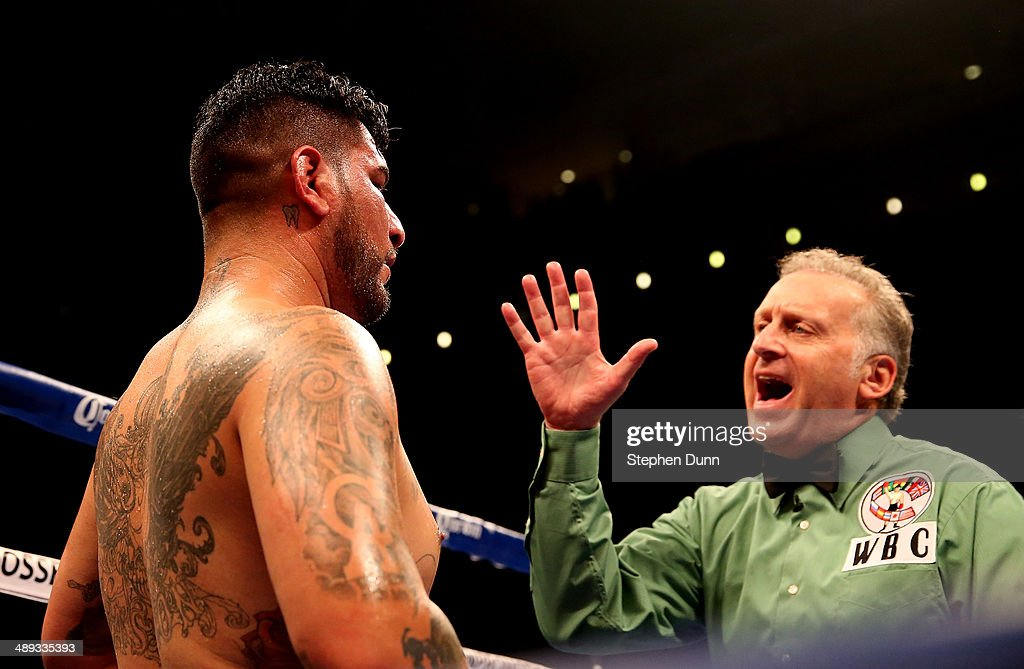 Referee Jack Reiss gives a count to Chris Arreola after a sixth round knockdown by Bermaine Stiverne at the end of the fourth round of their WBC Heavyweight Championship match at Galen Center on May 10, 2014 in Los Angeles, California. Stiverne won in a six round technical knockout.