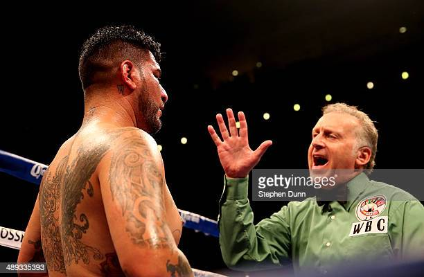 Referee Jack Reiss gives a count to Chris Arreola after a sixth round knockdown by Bermaine Stiverne at the end of the fourth round of their WBC...