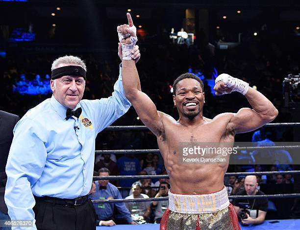 Referee Jack Reiss raises the arm of Shawn Porter after defeating Erick Bone during their 12 round welterweight bout at Citizens Business Bank Arena...