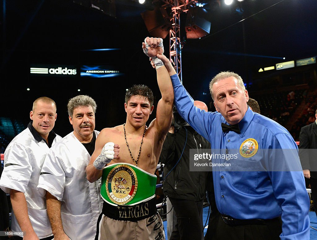 Referee Jack Reissholds up the arm of Jessie Vargas after a unanimous decision against Wale Omotoso during the WBC Continental Americas Welterweight Championship boxing match at The Home Depot Center on March 16, 2013 in Carson, California.