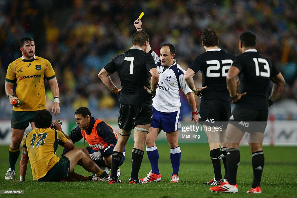 Referee Jaco Peyper gives a yellow card to Beauden Barrett of the All Blacks during The Rugby Championship match between the Australian Wallabies and...