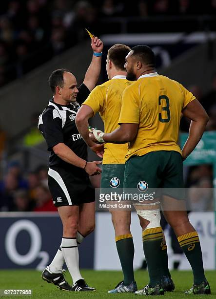 Referee Jaco Peyper shows a yellow card to Dane HaylettPetty of Australia during the Old Mutual Wealth Series match between England and Australia at...
