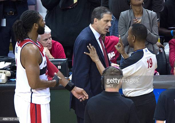 Referee James Capers explains to Washington Wizards head coach Randy Wittman that Wizards forward Nene Hilario is ejected from the game following an...