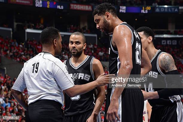 Referee James Capers speaks to Tony Parker and Tim Duncan of the San Antonio Spurs during a game against the Los Angeles Clippers in Game Seven of...