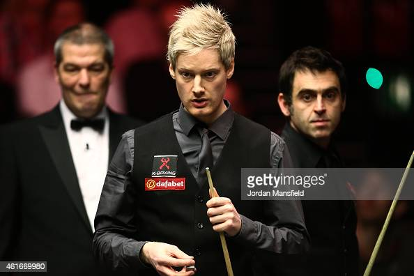Referee Jan Verhaas Neil Robertson of Australia and Ronnie O'Sullivan of Great Britain all look on during their semifinal match on day seven of the...