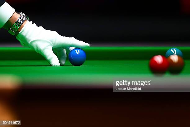 Referee Jan Verhaas places a blue ball during the first round match between Judd Trump of England and Stephen Maguire of Scotland during Day Two of...