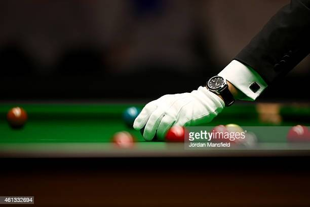 Referee Jan Verhaas replaces a ball on the table during the first round match between Mark Selby of England and Shaun Murphy of England on day one of...