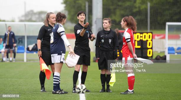 Referee Jane Simms Assistant referee's Stacey Hall and Natasha Wilson with Freya Bailes of Millwall Lionesses and Ruby Grant of Arsenal Ladies before...