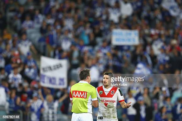 Referee Jared Maxwell speaks to Gareth Widdop of the Dragons during the round 14 NRL match between the St George Illawarra Dragons and the Canterbury...