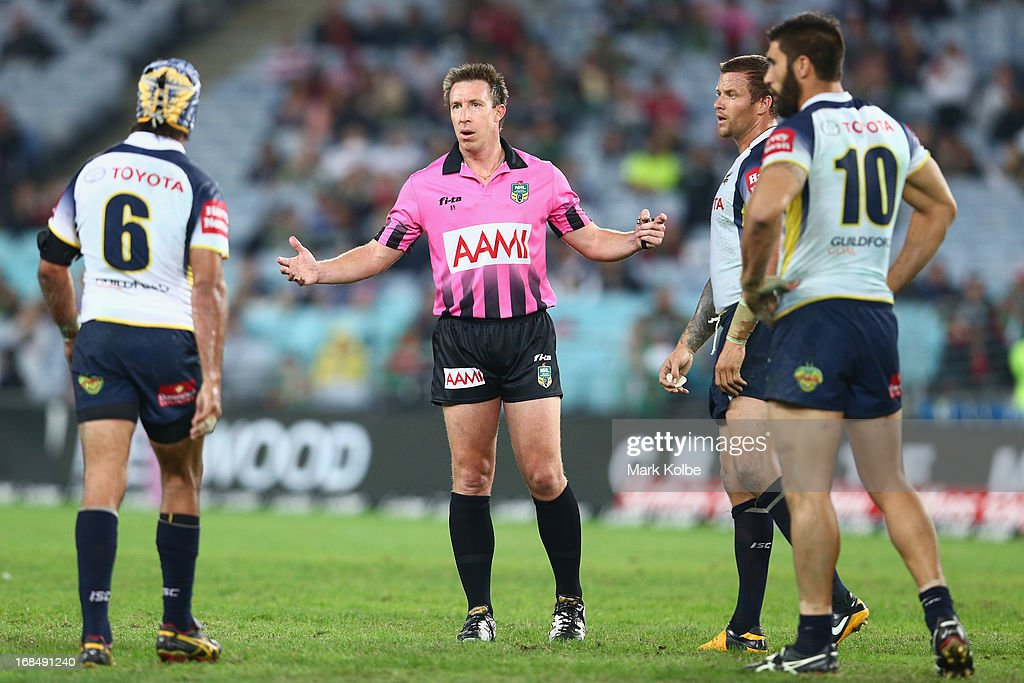 Referee Jared Maxwell speaks to Johnathan Thurston of the Cowboyus before placing Ashton Sims of the Cowboys on report during the round nine NRL match between the South Sydney Rabbitohs and the North Queensland Cowboys at ANZ Stadium on May 10, 2013 in Sydney, Australia.