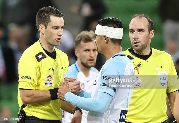 Referee Jarred Gillett and Tim Cahill of Melbourne City shake hands at the break during the round 11 ALeague match between Melbourne City FC and...