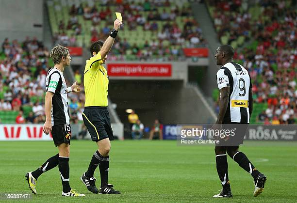 Referee Jarred Gillett gives a yellow card to Emile Heskey of the Jets during the round eight ALeague match between the Melbourne Heart and the...