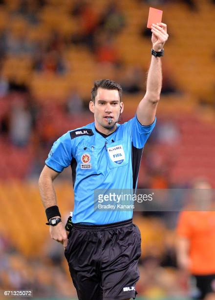 Referee Jarred Gillett hands out a red card to Jaushua Sotirio of the Wanderers during the ALeague Elimination Final match between the Brisbane Roar...