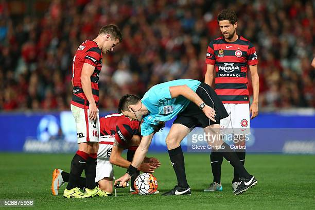 Referee Jarred Gillett marks the spot for a freekick during the round one ALeague match between the Western Sydney Wanderers and the Brisbane Roar at...
