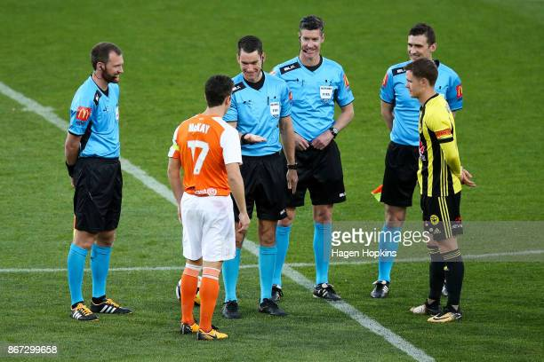Referee Jarred Gillett Matt McKay of Brisbane and Michael McGlinchey of the Phoenix take part in the coin toss during the round four ALeague match...
